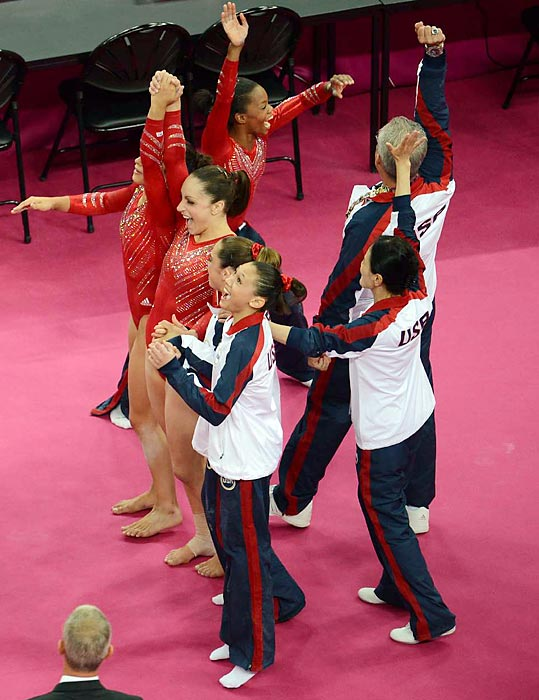 The elated and stuff-of-legends team celebrates its gold medal in team all-around finals. The 2012 team, nicknamed The Fab Five, left silver-medal Russia in the dust by a massive five-point lead.