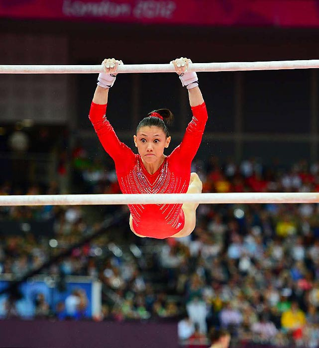 Kyla Ross shows the utmost concentration during her uneven bar routine .