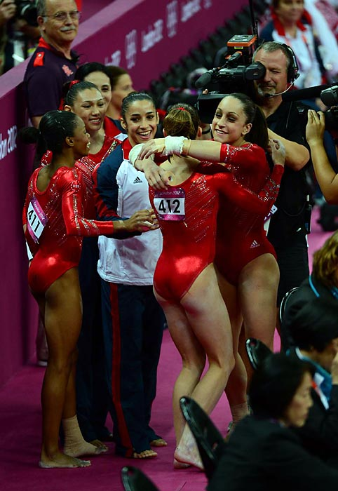 "The Women's Gymnastic Olympic Champions celebrate their gold together. The 2012 women's victory will be remembered as ""one of the most iconic moments,"" said former Olympian Shawn Johnson."