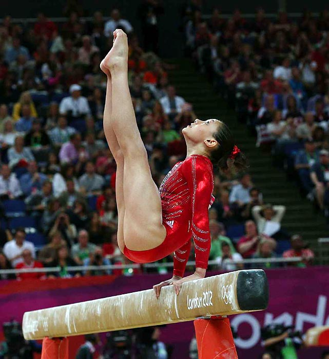 Kyla Ross showing her great form on the balance beam during the Olympic Team Finals. Ross competed on beam and uneven bars to help lead Team USA to gold.