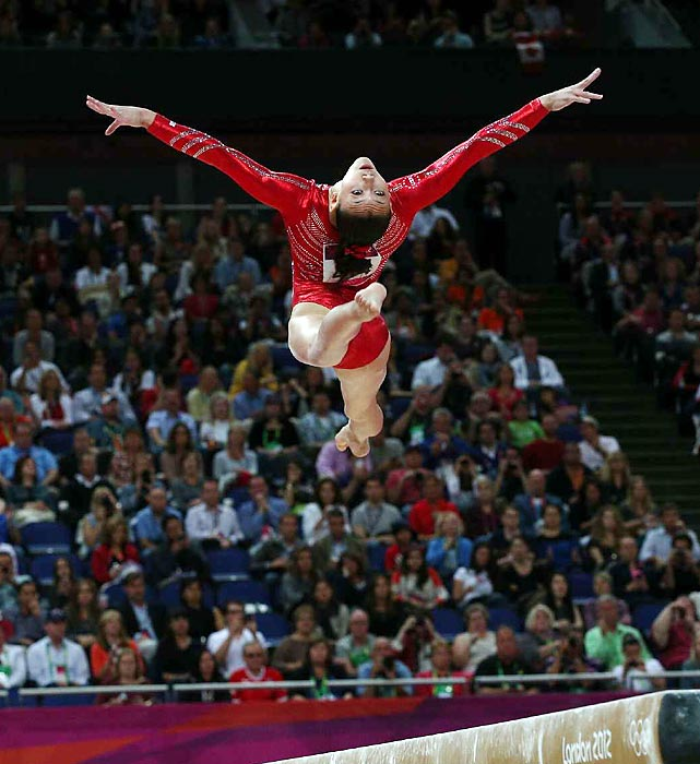 Kyla Ross, at only 15-years-old, exhibits perfect form on her balance beam routine. Ross made no major errors on her beam routine and scored 15.133 to help Team USA maintain its lead at the end of the third rotation.