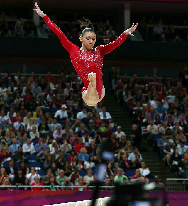 Kyla Ross leaps above the balance beam during Olympic Team Finals. After the beam routines in the third rotation, Team USA led Russia by over a point.