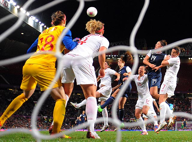 """The U.S. women's soccer team won one of the most exciting games team history in the Olympic semifinal, but two highly controversial calls allowed the United States to tie the game before Alex Morgan's winning header at the end of overtime. Morgan's 123rd minute header clinched a 4-3 win for the U.S., which came back from three separate deficits to fend off an exceptional Canadian side. The U.S. benefitted from an unusually rare delay-of-game call in the 80th minute after Norwegian referee Christiana Pedersen claimed Canada goalie Erin McLoed held the ball for six seconds. Megan Rapinoe's ensuing free kick from inside the box hit a Canadian defender, which Pedersen whistled a handball and awarded the U.S. a penalty kick. Abby Wambach would slot home the penalty to tie the game at 3. Canadian players were furious after the game, triggering Canada's Melissa Tancredi to say to Pedersen: """"I hope you can sleep tonight and put on your American jersey."""""""