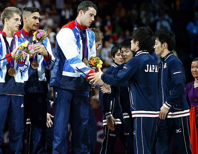 The men's gymnastics team final was held up by yet another scoring controversy as Japan went from off the medal stand to silver after successfully winning a late protest. With China well ahead and Great Britain angling for its first medal in 100 years, Japan appeared to have solidified a silver medal until three-time all-around world champion Kohei Uchimura shockingly received a 13.466. While the British crowd raucously celebrated a silver medal, Japan immediately protested and was subsequently rewarded. Uchimura's score was raised to 14.166 and Japan won the silver medal, knocking the British to bronze and Ukraine off of the podium.  Uchimura is pictured congratulating Great Britain's bronze medalists.