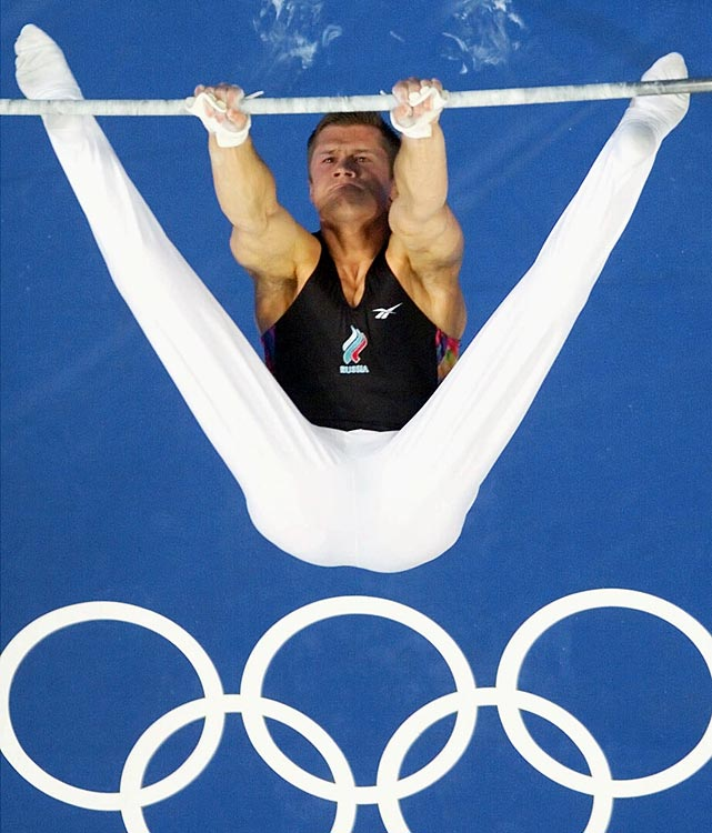 Russian gymnast Alexei Nemov accumulated his 12 medals over just two Olympic Games.  He participated in his third Olympics in 2004, and while he didn't medal, he was caught up in the middle of a scoring controversy in which he wasn't put into medal contention even after a very difficult high bars routine.  Nemov was known for his gamesmanship and his ability to push the limits.