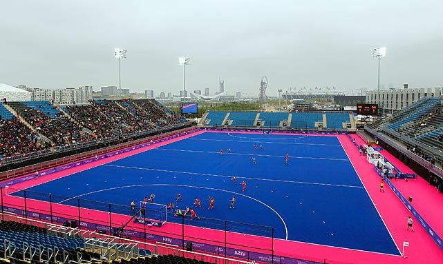 "The new temporary Riverbank Arena will host field hockey during the Games. The ""London Blue"" color of the playing field is meant to contrast with the yellow ball of the game, all while the Olympics' bright pink color will highlight the ring of the pitch. This will be the first time Olympic hockey has been played on a different color pitch than green. All hail Boise State."