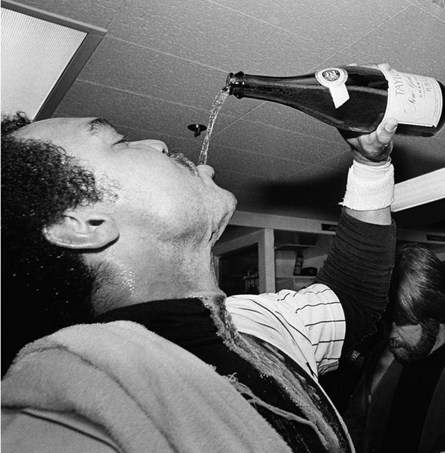 After defeating the Royals 2-1 to clinch the American League pennant, Jackson guzzles champagne in celebration.