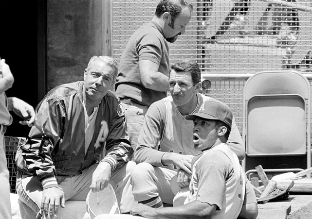 Jackson (right) sits with Joe DiMaggio (left) and John McNamara (center) before going to bat and hitting his 27th homer of the season in 1969.