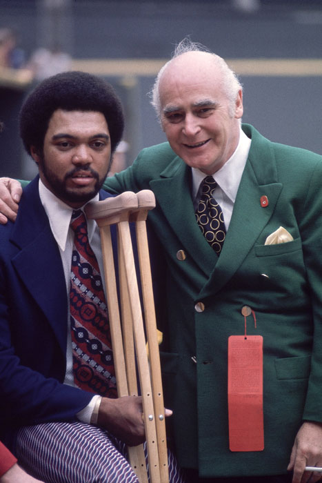 Athletics owner Charlie Finley poses with Reggie Jackson before Game 1 of the 1972 World Series against the Cincinnati Reds. The A's won the Series in Game 7, but Jackson did not play due to a hamstring injury.