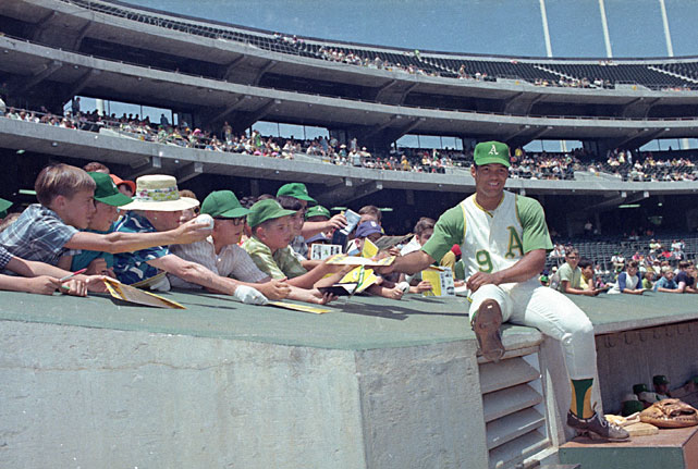 Reggie Jackson was admitted into the Baseball Hall of Fame 20 years ago on Aug. 1, 1993. SI takes a look back at the legendary outfielder's career, including this shot of 22-year-old Jackson speaking with A's fans at the Oakland Coliseum.