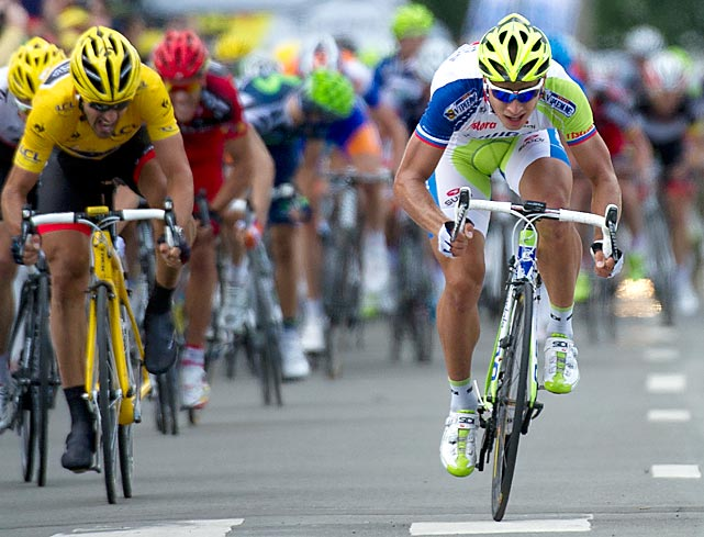 Peter Sagan (right) of Slovakia sprints to finish just ahead of prologue winner Fabian Cancellara, who retained the overall lead. Sagan and Cancellara were separated by less than one second in the 123-mile stage.