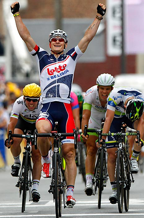 Andre Greipel celebrates his second stage victory in a row after sprinting ahead of Mark Cavendish (left) and Matt Goss (right). Peter Sagan, who won the first and third stages, missed his chance to sprint to the finish after a crash in the final two miles.