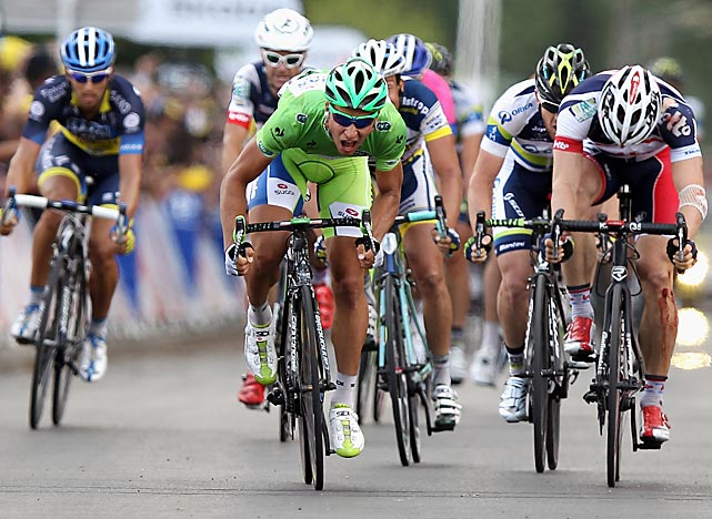 Peter Sagan won his third stage, avoiding a huge pile-up 16 miles from the finish in Metz and surging past two-stage winner Andre Greipel. Sagan kept the green jersey while Fabian Cancellara retained the yellow jersey.