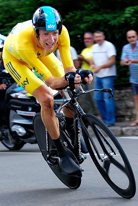 Bradley Wiggins crushed the Tour de France's first long time trial, beating runner-up fellow Sky teammate Christopher Froome by 35 seconds. Wiggins extended his lead to 1:53 on Cadel Evans, currently in second place overall.