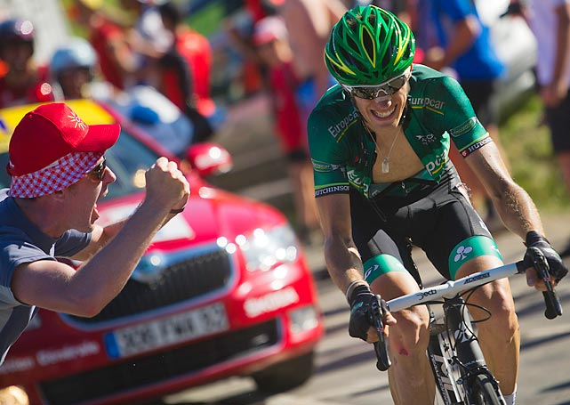 Europcar's Pierre Rolland conquered the Alps' grueling ascents in the Tour de France's stage 11, arguably the hardest stage of this year's Tour.