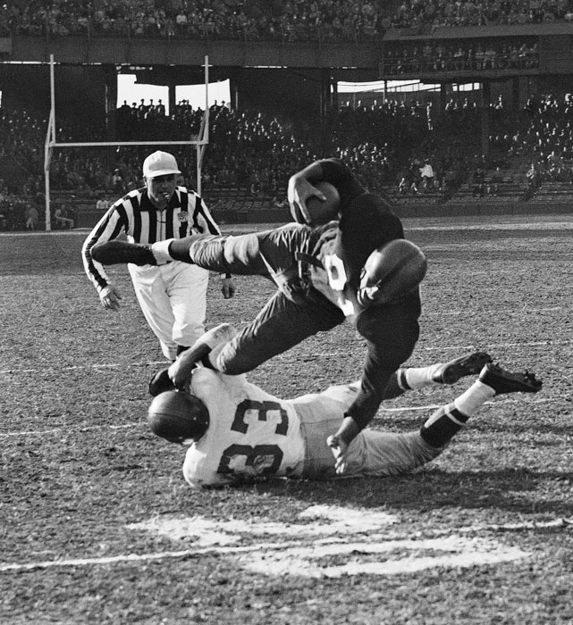 Russ Craft (33) of the Philadelphia Eagles gets a firm grip on Redskins halfback Rob Goode during the second quarter of this matchup in Washington.  Goode was brought down for no gain and the Eagles would edge the Redskins 35-21.