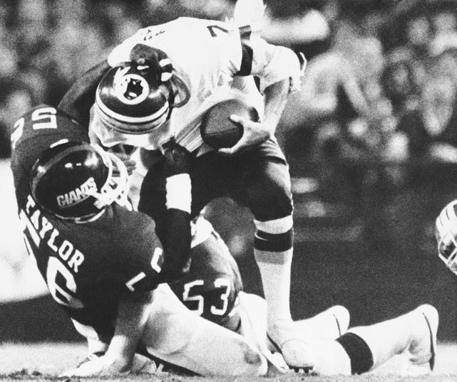"On this infamous play during a Monday Night Football matchup between the Redskins and the New York Giants, Lawrence Taylor foiled a flea-flicker attempt and gruesomely broke quarterback Joe Theismann's leg.  Thesimann, a Hall of Fame quarterback, would never return to the NFL after this play, which would become known as ""The Hit That No One Who Saw It Can Ever Forget""."