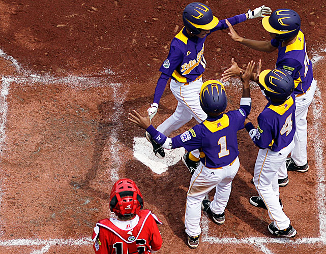 Aguadulce, Panama's James Gonzalez, Daniel Cruz, Rafael Eysseric and Edisson Gonzalez celebrate after a grand slam by James in the second inning of a pool play baseball game against Vancouver, British Columbia.