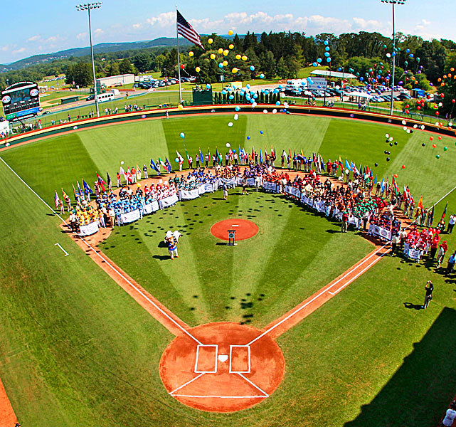 Players from the 16 teams participating in the 2012 Little League World Series release balloons during the opening ceremony.