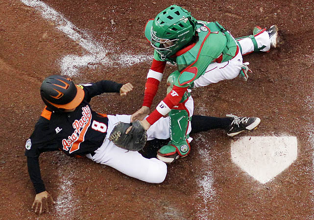 Taiwan's Cheng-Kai Hu is tagged out at by Mexico's Eduardo Abrego in the third inning. Mexico scored three runs in the third to take the lead, including two on a throwing error. Mexico manager Fernando Rios was suspended for two games after a player on his roster did not bat in the game.
