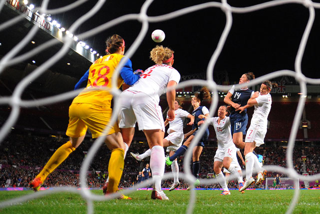 Morgan heads in the winning goal during the women's soccer semifinal match against Canada. The U.S. came from behind three times before Morgan's winning goal in extra time.