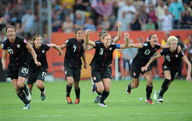 Morgan (13) and the rest of Team USA celebrate after teammate Ali Krieger scored the winning goal in penalty kicks to defeat Brazil in the quarterfinals of the 2011 Women's World Cup.