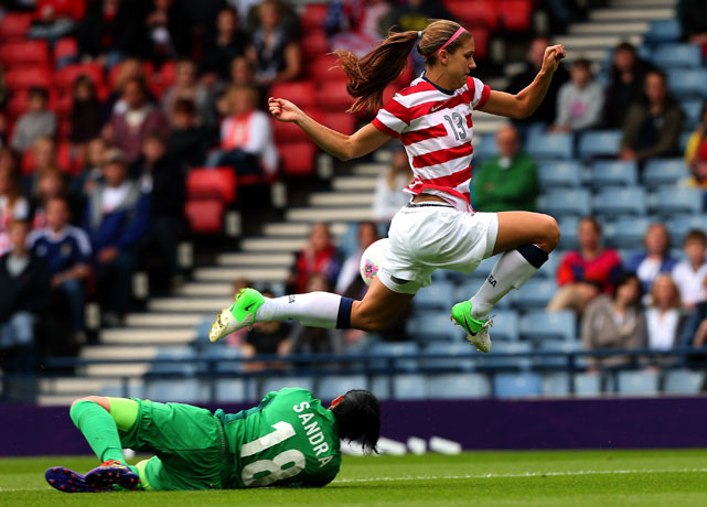 Morgan leaps over fallen defender Sandra Sepulveda during a first round match against Columbia during the 2012 London Olympics.