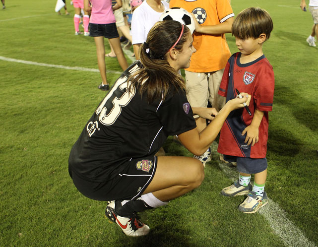 Morgan signs a young fan's jersey after the Western New York Flash defeated the Atlanta Flash in Aug. 2011.