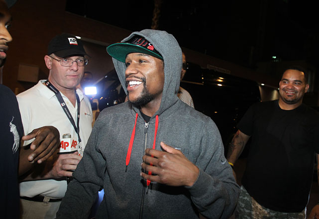 Mayweather wore a leather Miami Heat cap and gray hooded sweatshirt as he emerged from the Clark County Detention Center to meet about 20 family members and friends.