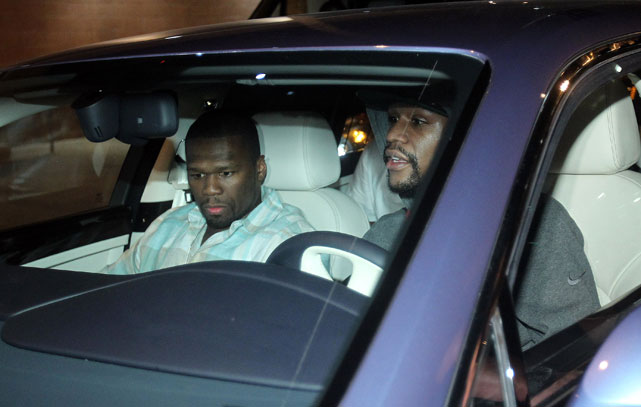 "Mayweather said nothing to the media as he got behind the wheel of a blue Bentley sedan with several friends inside, including rapper -- and recently licensed boxing promoter -- Curtis ""50 Cent"" Jackson."