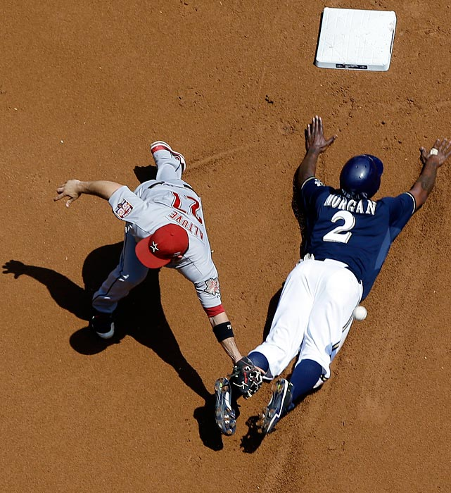 The eclectic Nyjer Morgan of the Milwaukee Brewers slides into second base as the throw gets underneath the glove of Houston Astros' Jose Altuve.  Morgan and the Brewers went on to win 13-4.