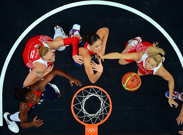 British center Azania Stewart, center, and British forward Temi Fagbenle, left,  battle down low with Russian center Irina Osipova, second from left, and Russian forward Anna Petrakova during the preliminary round.