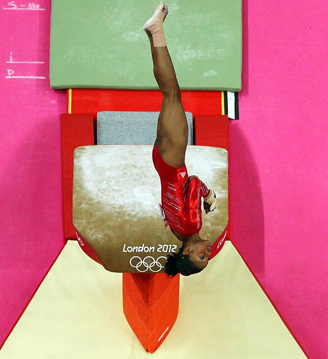 Individual All-Around champion Gabby Douglas does a routine on the vault during team competition.