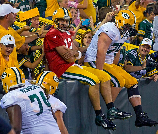 Aaron Rodgers does the famous Lambeau Leap next to offensive tackle Bryan Bulaga during the Packers intra-squad scrimmage last week.