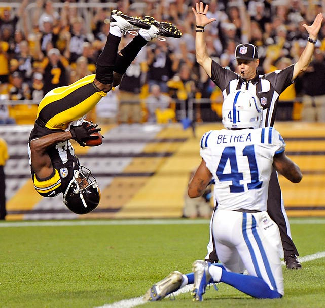 Inspired by the Olympics, Pittsburgh Steelers wide receiver Antonio Brown shows off his gymnastics skills and flips into the end zone over Indianapolis Colts defensive back Antoine Bethea for a touchdown during their preseason game.