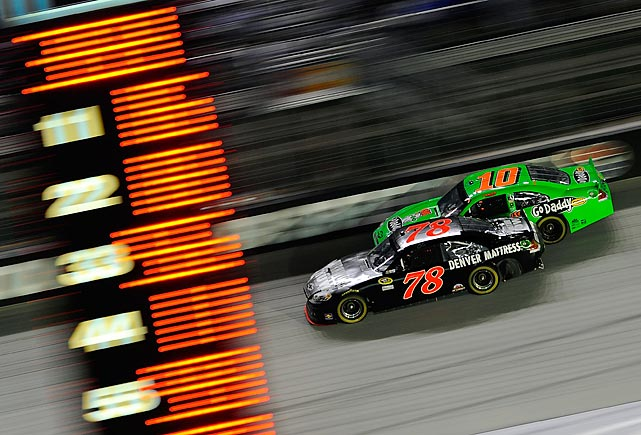 Regan Smith (78) battles to gain position against Danica Patrick  during the NASCAR Sprint Cup Series.