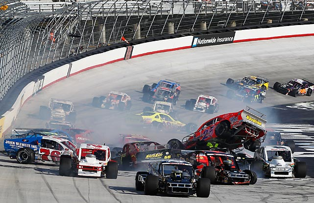 John Smith's car (25) goes airborne during the NASCAR Whelen Modified Tour UNOH Perfect Storm 150 at Bristol Motor Speedway in Tennessee.