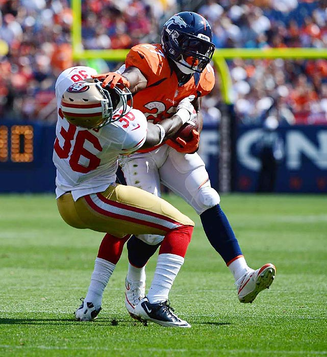 Denver's Knowshon Moreno puts a devastating stiff arm on San Francisco's Michael Thomas in an NFL preseason game in Denver.