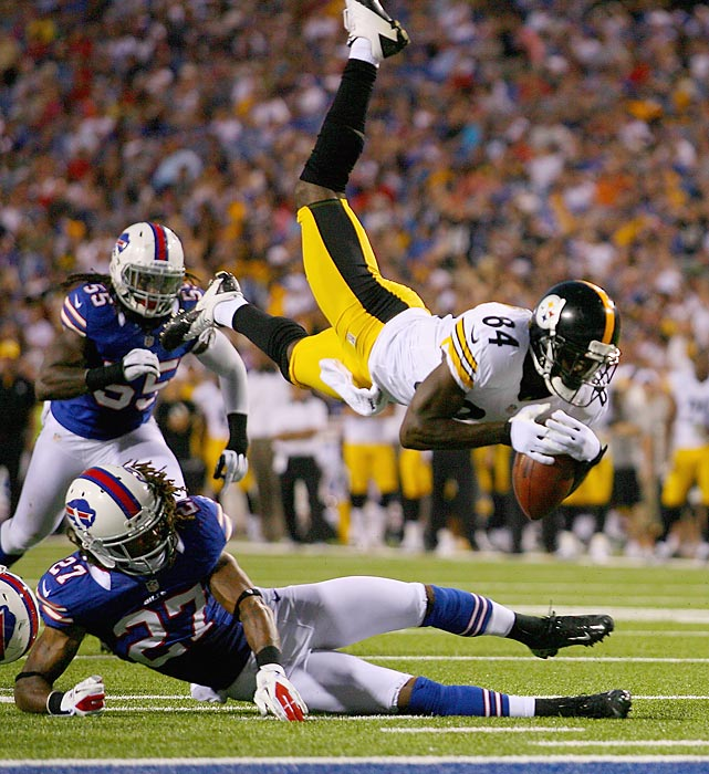 Pittsburgh's Antonio Brown  is hit by Buffalo's Stephon Gilmore in the first half of an NFL preseason game at Ralph Wilson Stadium in Orchard Park, NY. The Steelers dominated the Bills 38-7.