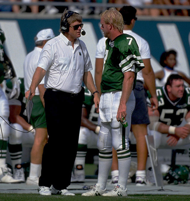 Boomer Esiason talks with coach Bruce Coslet on the sideline during a game against the Dolphins in 1993.
