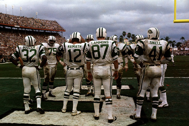 In Super Bowl III, Jets quarterback Joe Namath (12) stands in the end zone before a huddle before starting play against the Baltimore Colts at the Orange Bowl Stadium in Miami.