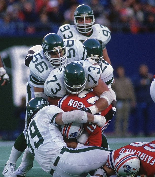 Patriots quarterback Tony Eason gets gang tackled by the Jets defensive line.