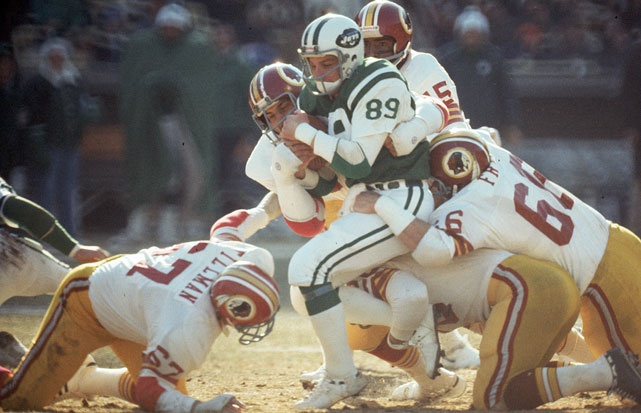 The Washington Redskins gang tackle Jets wide receiver Lou Piccone at Shea Stadium. The Redskins defeated the Jets 37-16.