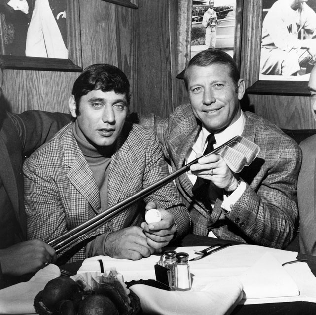 Jets quarterback Joe Namath (left) and former Yankees star Mickey Mantle pose at Namath's Bachelors III night spot in January 1969.