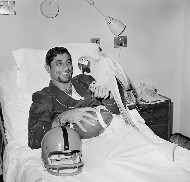 Joe Namath poses with a Macaw named Joe in his hospital room in New York City. Namath was recovering from right knee surgery, which was his second in his football career.