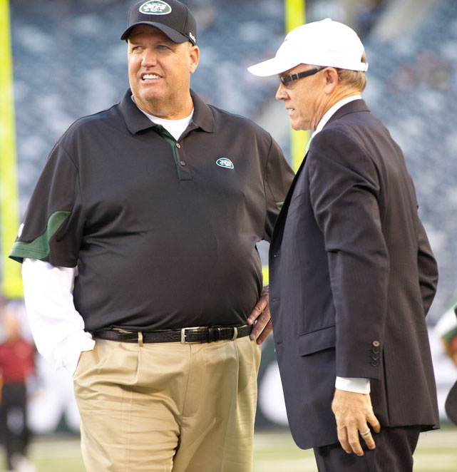 Rex Ryan converses with owner Woody Johnson before a preseason game against the Washington Redskins.