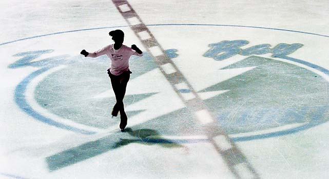 A figure skater glides across the Tampa Bay Lightning logo at the Ice Sports Forum, the Lightning's training facility, in Brandon, Fla., on Sept. 16, 2004, the day owners locked out the players.