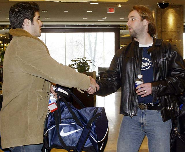 Goalies Rick DiPietro (left) of the Islanders and Robert Esche of the Flyers shake hands as they leave a meeting with other locked-out players and the NHL Players Association on March 1, 2005.