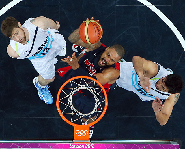 Tyson Chandler gets the job done for the U.S. against Argentina's Andres Nocioni (13) and Carlos Delfino.