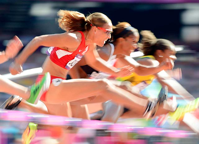 Lolo Jones took an easy first in her heat to qualify for Tuesday's semifinals.